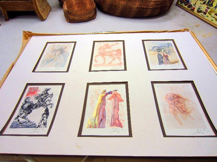 Montage of limited edition Dali prints. Frame is broken.