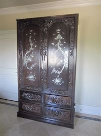 Ornate rosewood with inlay armoire