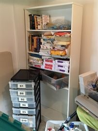 White bookcase, storage containers and tons of office supplies