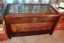 Heavily Carved, Antique Trunk With Oriental Theme Inlaid Glass Top Over Garden Scene All Sides With Carved Images, With Tray Insert