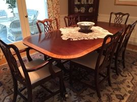 Beautiful Council Craftsman Dining Table with 3 leaves and 6 Chairs. Rug for sale too.