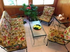 mid century wrought iron patio . original canvas and vinyl cushions are in great shape, had been covered in canvas for 20 years and inside
