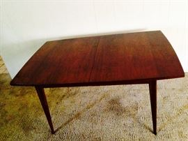 Fabulous and solid walnut mid century dining table with  one leaf