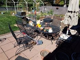 Rod Iron Patio furniture, lawn mowers, weed wackers, bbq, smoke pit, tools, and much more in shed.