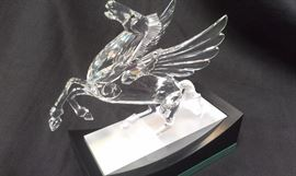 SWAROVSKI CUT CRYSTAL Pegasus w stand, mint w original box and signed w swan etched logo. Look for many more Swarovski pieces coming up.UPDATE: he has been found. was MIA during setup so come early to get him. He has COA and original box