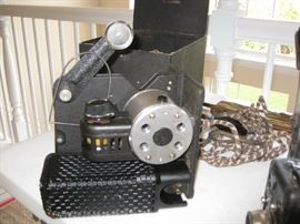 Small vintage projector with black case and cord