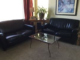 Leather love seats, metal coffee table