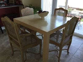 "Solid bleached oak Parsons table, 42"" square w/2 18"" leaves;  Pickled Pine country French dining chairs with wicker seats and backs"
