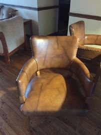 Leather barrel chairs with brass studs
