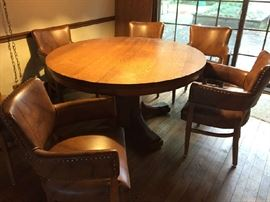 Beautiful Round table that has leaves to open larger, Solid Oak, Great leather barrel chairs with brass studs