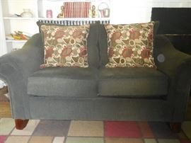 Matching Ashley Furniture Charcoal Love Seat with Pillows
