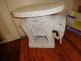 One of 2 of these wicker elephant tables