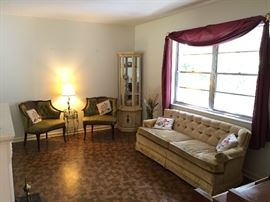 SET OF GREEN CHAIRS, SOFA, LAMPS, CURIO, NEEDLE POINT PILLOWS, WINDOW TREATMENTS, ENTERTAINMENT CENTER, TV, DVDS, BOOKS, ETC,