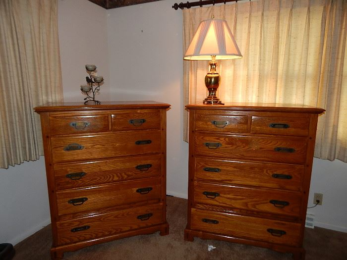 Pr of matching Oak chest of drawers, circa 1950's made of solid wood and signed by manufacturer