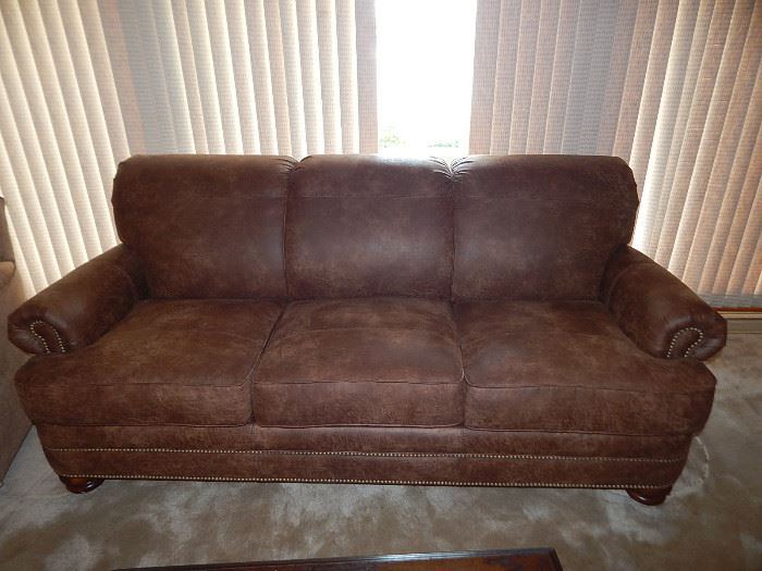 Like new Flexsteel sofa.  It is a leather like fabric and is in excellent condition.