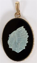 """Lot#32, CARVED OPAL AND ONYX PENDANT, H 1 1/8""""A carved opal depicting a Native American man mounted on onyx in a 14KT yellow gold pendent."""