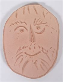 """Lot#113, PABLO PICASSO, MADOURA POTTERY MEDALLION, #21/500, H 3 1/4"""", W 2 1/2""""Oval shape ceramic unglazed medallion with an impressed smiling face. Picasso Madoura stamp and numbered: 21/500 on the verso."""