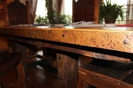 Hand hammered copper edged trim with nail head finish. The top of this table was constructed from 18th Century barn wood.