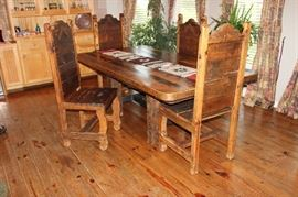 Dining table.  Handmade 17th century barn wood, detailed with hand hammered copper and iron trim.  With 8 chairs, (4 not pictured)