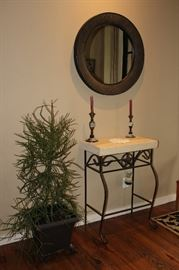 stone slab entry table, candlesticks, mirror, plant