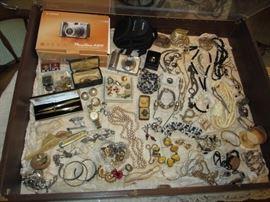 camera, jewelry, pens, knife