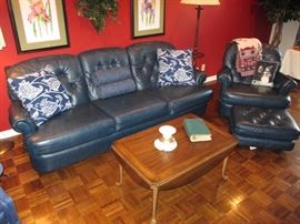 Navy blue leather sofa, chair and ottoman