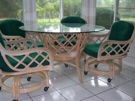 Beautiful Rattan Glass Top Table w/ (4) Swivel Chairs (on casters)