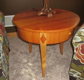 round maple table with inlays