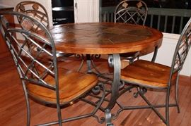 Originally purchased at Benson Stone. Tile top dining set.