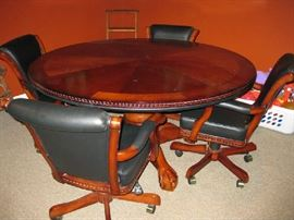 nice wood game table with 4 rolling leather chairs