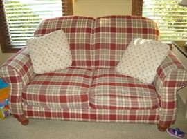red plaid love seat, one of two.