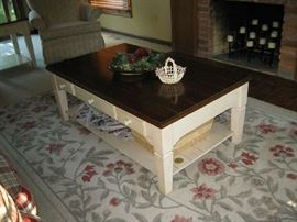coffee table and and wool rug