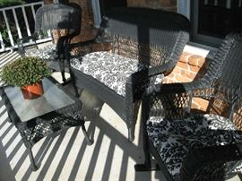 out door wicker furniture, two rockers, love seat and table.