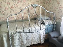 Twin size bed; ornate metal full size headboard.