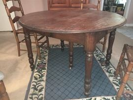 Antique oak dining table with center leg; 4 maple ladder back chairs.