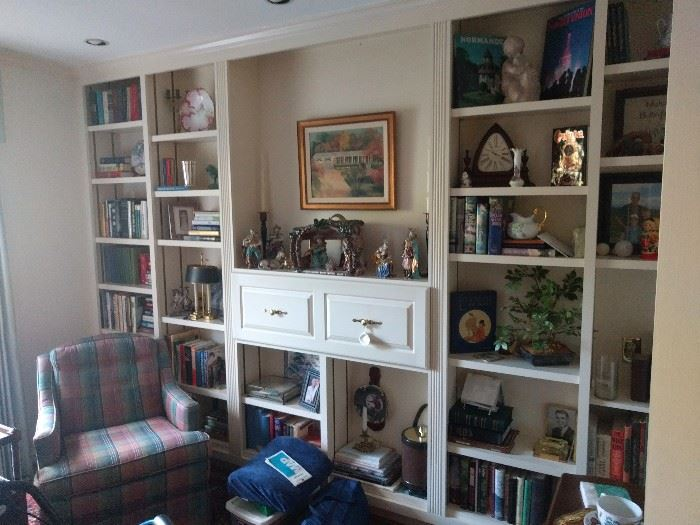 Great room bookshelf, filled with (you guessed it!) books, collected small treasures, bling, blang and a pinch of bada boom.