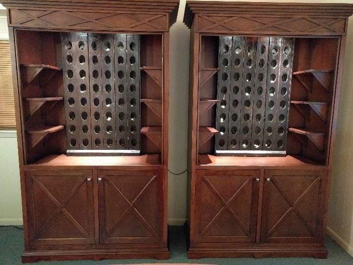 A wonderful pair of custom made, illuminated wine cabinets. The next pic shows them opened.