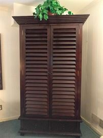 Tommy Bahama-esque louvered linen press, entertainment center thing. It's an open and shut case, just review the next picture. This thing is super heavy and will outlast a Tsunami!