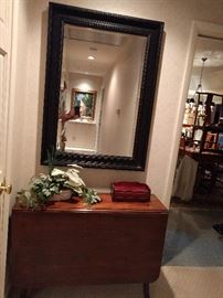 McMansion black-framed mirror, lording over a very nice 1940's mahogany drop-leaf table. The next pic shows you how nice the detail is on the side.                               NO, I'm not drunk, the house is tilted!