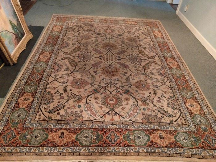 Hand woven, 100% wool Indian rug, Agra design, measures 8' x 10'.