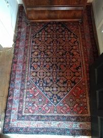 "Right as you enter the front door, to announce that these people had $$$ and taste, is a hand-woven, 100% wool Persian Bidjar rug. The colors are fabby, condition is very good, with even pile; measures 3' 4 x 6' 7""."
