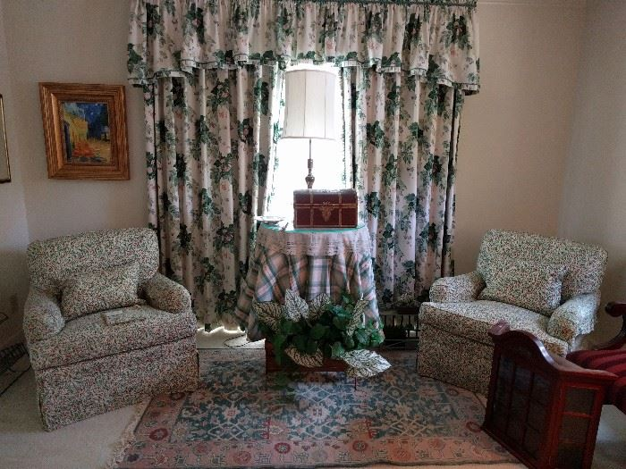 Nice pair of upholstered armchairs, by the Charles Stewart Co., Hickory, NC, covered in Brunschwig & Fils pink/green Ciruelas print; the God-awful high mortuary-style window treatments are also for sale.                      Please come buy them!