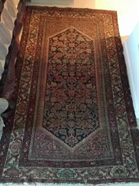 "Ahh, now here's a rug you won't see very often. It is a hand-woven, 100% wool Persian Malayer rug, that's at least 80 years old. The colors are fabby, condition very good, with even pile; measures 3' 4 x 6' 7""."