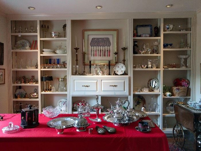 A dining room FULL of very nice collectibles, lot's of silver plated hollowware and some good pieces of sterling.