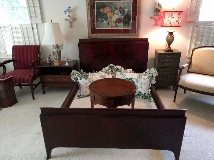 Very nice 1940's mahogany full size bed, with waterfall design and beautifully matched veneers and comes complete with head/foot board and side rails. The round drum table is a one-drawer, by Hekman