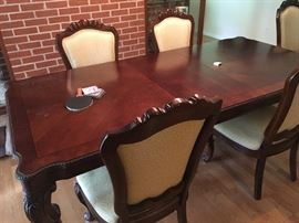 Large solid wood dining table with 2 leafs
