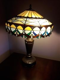 Tiffany style leaded shade and metal light fixture.