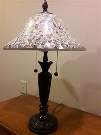 Tiffany style shade with metal lamp.