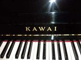 """Kawai CX-10 Upright Piano with High-Gloss Black Finish in Pristine Condition: Full 44"""" Height, Ultra-Responsive, Exclusive ABS Styran Action Parts, Solid Spruce Soundboard, Four Laminated Backposts, Nickel Plated Tuning Pins, Toe-Block Design with Casters for Easy Moving. Tufted Black Stool Included (seat is 22"""" wide and 14"""" deep). Seat has Adjustable Height."""