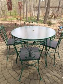 1950s Ivy Leaf wrought iron table and 4 chairs. Glass Table Top.